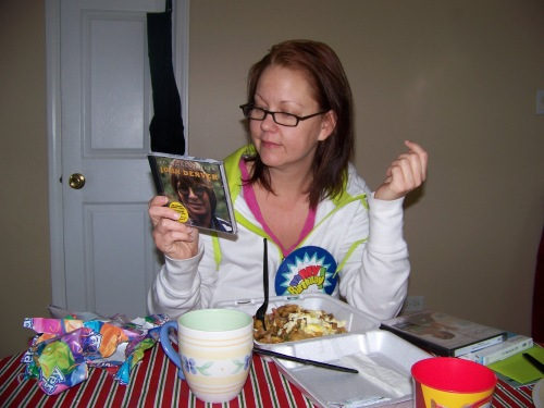 Eating breakfast take-out while checking out my new John Denver Greatest Hits album while wearing my Mrs. Kenny readers.